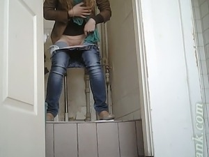 Young blondie pulls down her jeans and pisses in the toilet