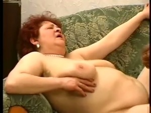 Two redhead mature white ladies on the couch having FFM threesome