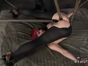 Redhead bondage cowgirl feasted with toys in BDSM porn