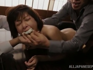 Two men are penetrating a delightful Asian babe
