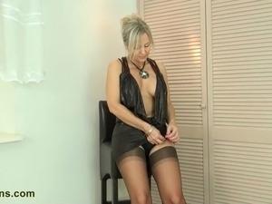 Watching her pose in pantyhose