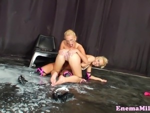 Milk enema lezzies getting wet and messy