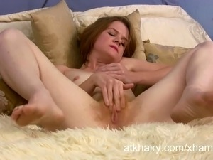 Zia loves being hairy and fingering her pussy