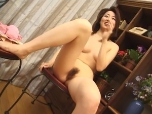 Bored Asian housewife gets naked and teases her hairy twat