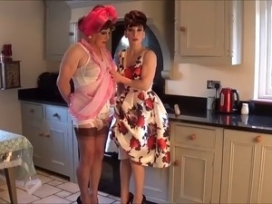 Madame C spanks Angelica in the kitchen