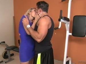 Fabulous curvy blonde white lady in the gym feels horny for young white man