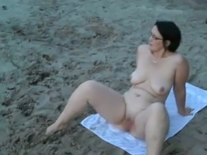 My perfect wife taking sunbath on the nudist beach