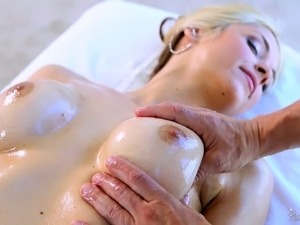 Masseur oils up a busty client and fucks her sexy trimmed pussy