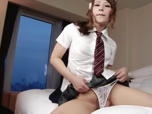 Attractive shemale takes a shower as she massages her hard cock