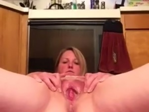 MILF pissing in the kitchen