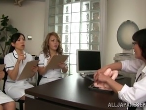 Japanese nurses in uniform hold toys and give handjob in group sex