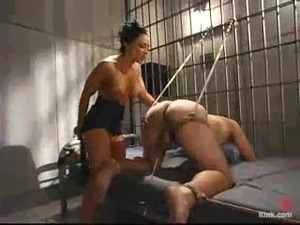 Mistress in police uniform toys and humiliates an inmate