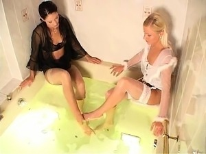 British lesbian threesome in stockings on a leathersofa