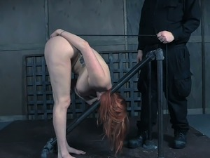 Pale skin curvaceous white lady restrained in doggy style position nude