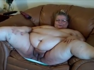 Extremely fat and flabby bodied mature slut teases herself on the sofa