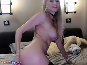 Teen blonde solo fingering on the bed