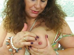 English milf Gilly pleasures her large boobs and wet cunny