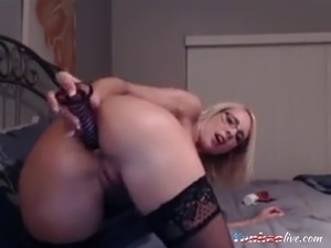 Hot milf in glasses with a sexy tight body masturbating her holes