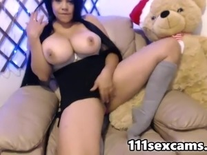 Hot latina teen with fantastic giant natural boobs in front of the webcam