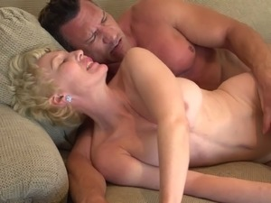 Lingerie-clad granny with short blonde hair enjoying a hardcore cowgirl style...