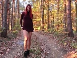 Sexy bright babe with bright red hair strips and flashes tits in the woods