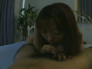 Cute Asian girl in light pink nightie does her best during HJ and blowjob