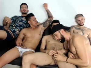 Four gorgeous gay boys engage in group sex on the webcam