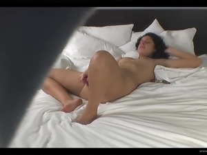 Brunette babe with nice ass masturbates behind hidden cams in solo scene