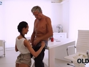 Young tanned secretary Liliane gets pounded doggy by her old boss