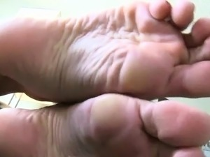 Sexy beauty gets feet licked while playing with a big dildo