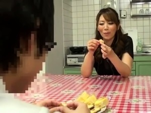 Enticing Japanese milf has a group of boys sharing her pussy