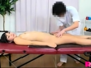 Asian massage babe sucks and jerks cock hard after massage