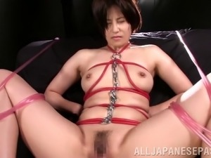 Pretty Asian sex slave with big boobs being tortured and vibrator fucked