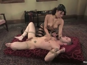 Exotic mistress is torturing her lover in BDSM