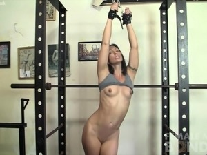 Fit Sexy Muscle Girl is Chained Up In The Gym